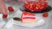 A slice of strawberry mousse cake.