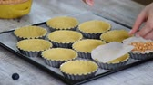 Pastry chef making tartlets at kitchen of pastry shop. Pastry. Sweet tartlets dessert Wideo