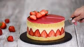 Strawberry cake. Fraisier cake on wooden background. Wideo