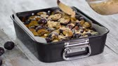 crumble : The process of making a fruit pie. Woman hands sprinkle crumble on the plum cake.