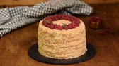 tejsodó : Confectioner decorates Napoleon Layered Cake With fresh Raspberry and Mint. Stock mozgókép