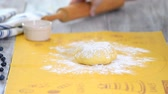 backen : Woman rolls dough with a wooden rolling pin. Videos