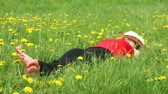 beautiful woman lying on a summer meadow