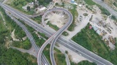 optimization : Optimized traffic on modern road overpass, connecting urban areas , aerial view Stock Footage