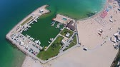 Top down view of the marina and the main beach in Eforie Nord , an attractive travel destination for summer vacations on the Black Sea coast , Romania, Eastern Europe , aerial shot