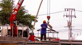 flagstone : KOH SAMUI, THAILAND - JUNE 21: Crane activity at construction site, workers carry concrete slabs. Video