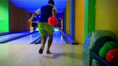 bowling alley : Young man playing bowling at night. Straight beats