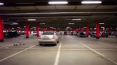 pár : Parking garage, underground interior with a few parked cars