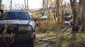krajina : SUV got stuck in the mud and trying to go out in the autumn forest