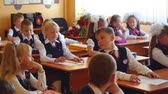 first class : Novosibirsk, Russia - september, 1, 2015. First-grade students and teacher are in school classroom at first lesson. The day of knowledge in Russia.