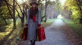 shopping bag sale : Mature elegant woman in age wearing hat and coat holding colorful shopping bags, autumn concept. 1920x1080