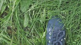 shaky : Female feet in sneakers walks on the green grass in slow motion. 1920x1080 Stock Footage