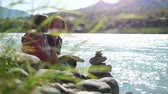 everlasting : Young women relaxing on nature putting pebble stack next to the mountain river in slow motion in sunny day. 3840x2160