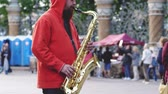 performing arts event : Russia, St. Petersburg, 21 june 2017. Street musician playing the saxophone at the outdoor area. 3840x2160 Stock Footage