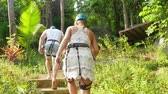 uganda : Thailand, Koh Samui, 26 january 2016. Tourists walk along the path in the jungles of Thailand. Mountain trail in the jungle. 3840x2160 Stock Footage