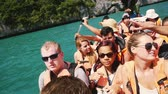 canoe : Koh Samui, Thailand, 14 february 2016. Unidentified young tourists traveling in the boat on the sea. slow motion. 1920x1080 Stock Footage