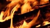 hotbed : Closeup burning firewood in the stove on black background Stock Footage
