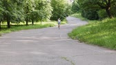 запустить : Young girl runner running along the track among the park