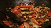 grill sauces : Chinese food in wok, mixing, 2 clips sequence Stock Footage
