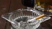 cigarro : closeup of a cigarette smoking and beer