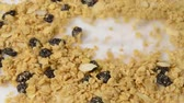 orzechy : Granola pouring and forming into a background Wideo