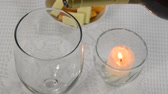 tomada : Placing a candle on a table and pouring Burgundy wine