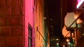 уличный свет : Establishment shot from an alley up the sides of a colorful building at night