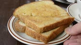 Serving a plate of buttered toast on a table