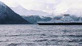 Ferry on the fjord with snow mountains, near volda (norway) Wideo