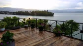destino de viagem : Lake Kivu view from restaurant with rain