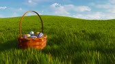 vime : Basket with colorful easter eggs among green grass