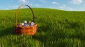 vime : Basket with dyed easter eggs among grass Close-up