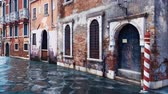 balcony view : Ancient venetian buildings along the water canal