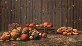 Colorful pumpkins and falling autumn leaves on wooden background with copy space