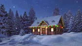 Solitary snowbound half-timbered rustic house decorated for Christmas among snow covered fir tree forest at snowfall winter night Stock Footage