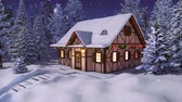 Snow covered half-timbered rustic house decorated by christmas lights among snowbound fir forest at calm winter night during snowfall Stock Footage