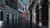 Empty narrow venetian street with flooded pavement and ancient buildings during catastrophic High Water flood Acqua Alta in Venice at rainy evening Stock Footage