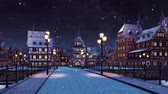 Cozy medieval town with traditional half-timbered european houses and empty road over the bridge lit by street lights at calm winter night during snowfall Stock Footage