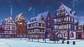 Empty snow covered street of cozy medieval town with traditional half-timbered european houses at snowfall winter evening with half moon in the sky