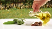 kosmetyki : Healthy Walnut oil pouring in to white saucer. Walnut healthy oil.