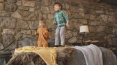 zoon : Two children toddler playing and jumping on the bed, childhood happiness concept