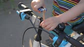 zoon : close up hands of little boy repairing bike