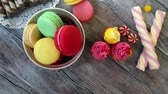 acıbadem kurabiyesi : Candy, cupcakes and macaroons on a rustic wooden background, top view Stok Video