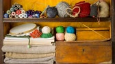bobina : Shelves filled by materials and tools for handmade. Burning incense stick