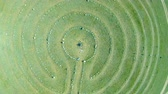 mysterious : Aerial view of stone labyrinth. The drone, rise up above the stone circles Stock Footage