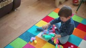 баловать : A small child indulge with a toy does not want to play with it