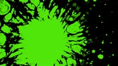 caligrafia : Effect with a drop of bright green paint on the water surface