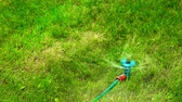 irrigação : Plastic water sprayer in motion on a hot summer day HD 1920x1080