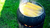 pannocchia : Cooking corn on fire in a black pot HD 1920x1080