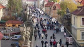 gotic : Aerial view of people walking on the Charles Bridge at sunset.